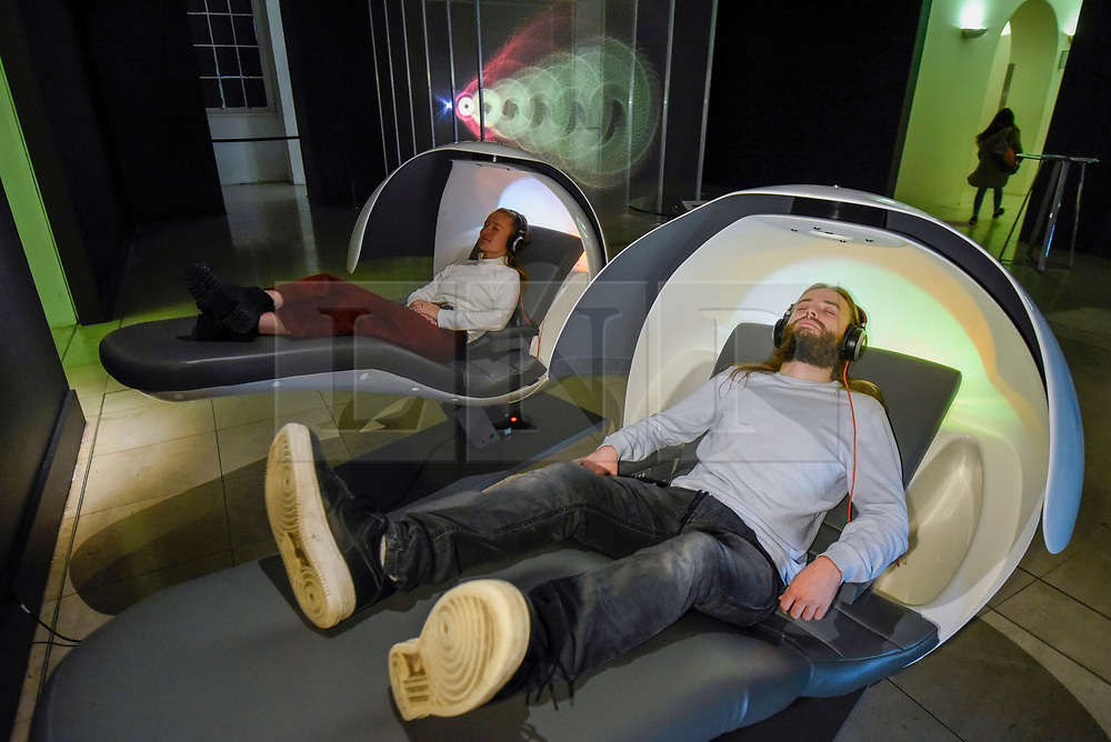 """© Licensed to London News Pictures. 29/10/2019. LONDON, UK. Staff members experience """"MetroNaps EnergyPods"""".  Preview of """"24/7: A Wake-Up Call For Our Non-Stop World"""", a new exhibition opening on 31 October at Somerset House.  The show examines our inability to switch off from our 24/7 culture.  Over 50 multi-disciplinary works explore the pressure to produce and consume information around the clock. taking visitors on a 24-hour cycle from dawn to dusk through interactive installations.  Photo credit: Stephen Chung/LNP"""