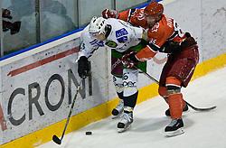Egon Muric of Olimpija vs Sabahudin Kovacevic of Jesenice at 14th Round of EBEL league  ice hockey match between HK Acroni Jesenice and HDD Tilia Olimpija Ljubljana, on October 16, 2009, in Arena Podmezaklja, Jesenice. (Photo by Vid Ponikvar / Sportida)