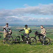 Portrait of 3 male mountain bikers, North York Moors, North Yorkshire, UK