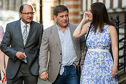 London, UK. 23 July, 2019. Guests including Shailesh Vara (l), Conservative MP for North West Cambridgeshire, and Andrew Bridgen (c), Conservative MP for North West Leicestershire, arrive to attend a celebration in Westminster of Boris Johnson's election as Conservative Party leader and replacement of Theresa May as Prime Minister organised by the pro-Brexit European Research Group (ERG).