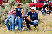 """09 SEPTEMBER 2007 -- ST. MICHAELS, AZ: Spectators at a traditional Navajo Horse Race in the summit area of the Navajo Indian reservation about 10 miles west of St. Michaels, AZ. Traditional horse racing is making a comeback on the Navajo reservation. The races are run on improvised courses that vary depending on the local terrain. Use of saddles is optional (except in the """"Cowhand Race"""" which requires a western style saddle) and many jockeys ride bareback. The distances vary from one mile to as long as thirty miles. Traditional horse races were common until the 1950's when they fell out of favor, but there has been a resurgence in traditional racing since the late 1990's and now there is a traditional horse racing circuit on the reservation. The race was organized by the Begay family of Steamboat, AZ and run on private land about three miles from a paved road.  Photo by Jack Kurtz"""
