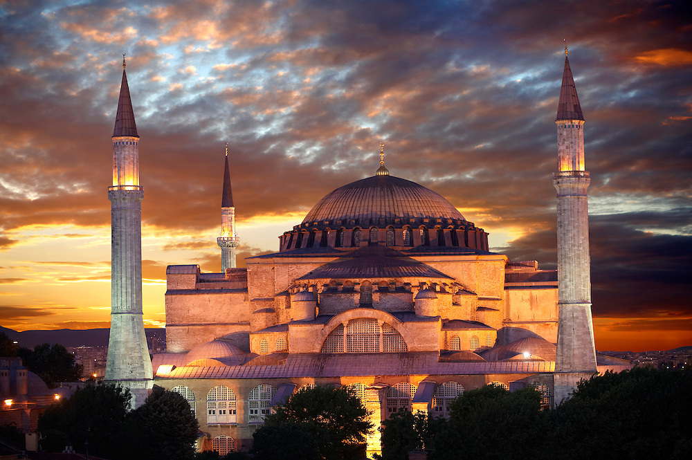 The exterior of the 6th century Byzantine (Eastern Roman) Hagia Sophia ( Ayasofya ) at sunset, built by Emperor Justinian. The size of the dome was un-surpassed until the 16th century, Istanbul, Turkey .<br /> <br /> If you prefer to buy from our ALAMY PHOTO LIBRARY  Collection visit : https://www.alamy.com/portfolio/paul-williams-funkystock/istanbul.html<br /> <br /> Visit our TURKEY PHOTO COLLECTIONS for more photos to download or buy as wall art prints https://funkystock.photoshelter.com/gallery-collection/3f-Pictures-of-Turkey-Turkey-Photos-Images-Fotos/C0000U.hJWkZxAbg