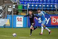 Scunthorpe United Junior Brown (12) Barrow Patrick Brough (3) battles for possession during the EFL Sky Bet League 2 match between Barrow and Scunthorpe United at Progression Solicitors Stadium, Barrow, United Kingdom on 16 January 2021.
