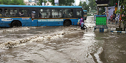 July 26, 2018 - Kolkata, West Bengal, India - Traffic is affected die to heavy rain that caused water logging in Saltlake sector 5. (Credit Image: © Tirthankar Das/Pacific Press via ZUMA Wire)