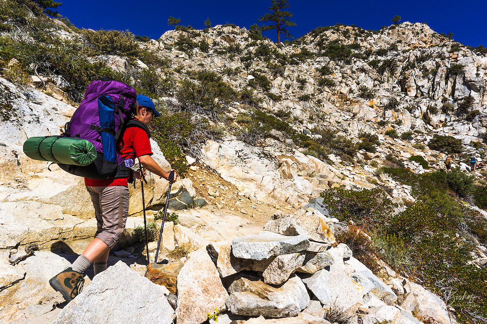 Backpacker on the North Fork of Big Pine Creek, Inyo National Forest, California USA