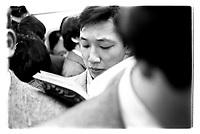 Man reading during rush hour in Tokyo subway, Japan. 1987