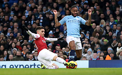 Arsenal's Lucas Torreira (left) and Manchester City's Raheem Sterling battle for the ball