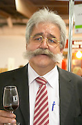 Languedoc. ISO standard shape wine tasting glass. France. Europe. Man with big mustach.