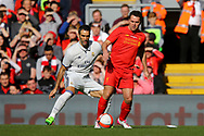 Fernando Sanz of Real Madrid legends (l) team and Michael Owen of Liverpool legends team in action. Liverpool Legends  v Real Madrid Legends, Charity match for the LFC Foundation at the Anfield stadium in Liverpool, Merseyside on Saturday 25th March 2017.<br /> pic by Chris Stading, Andrew Orchard sports photography.
