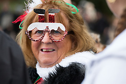 © Licensed to London News Pictures. 25/12/2017. Sutton Coldfield, Near Birmingham, UK. The traditional Christmas morning swim taking place at Blackroot Pool in Sutton Park earlier today. The free event attracts people who like to dress up in Christmas outfits and take the plunge into the open water, a different way to celebrate Christmas day. Photo credit: Dave Warren/LNP