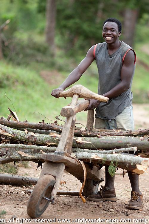 Photo Randy Vanderveen.Nyrusange, Rwanda.A Rwandan man with a wooden bike used to haul wood.
