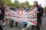 Veterans against terrorism flag during the Football Lads Alliance march between Park Lane and Westminster Bridge, London on 7 October 2017. Photo by Phil Duncan.