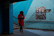 A lone woman enters the underpass leading into the Old Street station in Shoreditch, on 4th November 2019, in London, England.