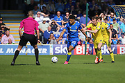 AFC Wimbledon striker Lyle Taylor (33) holding off Bristol Rovers midfielder Chris Lines (14) during the EFL Sky Bet League 1 match between AFC Wimbledon and Bristol Rovers at the Cherry Red Records Stadium, Kingston, England on 8 April 2017. Photo by Matthew Redman.