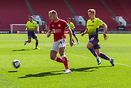 Bristol City's Captain Andreas Weimann (14) under pressure from Exeter City's Archie Collins (10) during the EFL Cup match between Bristol City and Exeter City at Ashton Gate, Bristol, England on 5 September 2020.