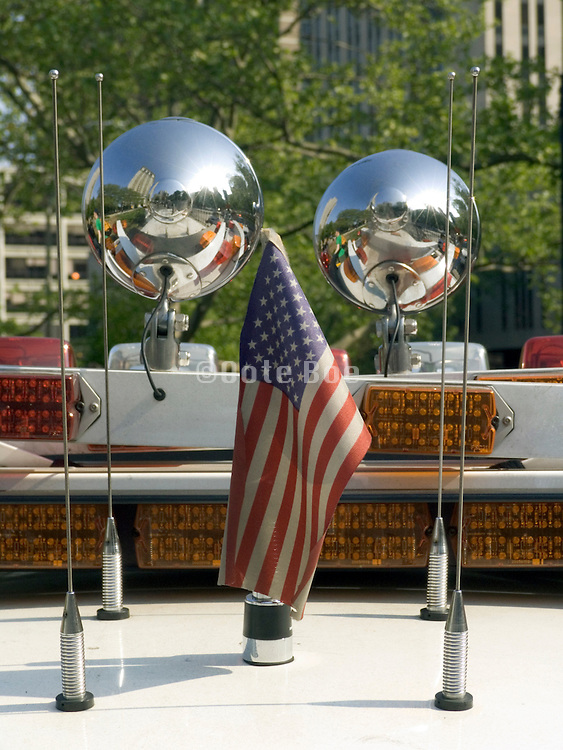 close up of a New York City police car alarm lights with a little American flag