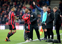 """AFC Bournemouth's Jermain Defoe (centre) is substituted on for AFC Bournemouth's Callum Wilson (left) during the Premier League match at the Vitality Stadium, Bournemouth. PRESS ASSOCIATION Photo. Picture date: Saturday March 17, 2018. See PA story SOCCER Bournemouth. Photo credit should read: Mark Kerton/PA Wire. RESTRICTIONS: EDITORIAL USE ONLY No use with unauthorised audio, video, data, fixture lists, club/league logos or """"live"""" services. Online in-match use limited to 75 images, no video emulation. No use in betting, games or single club/league/player publications."""