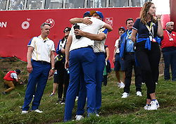Team Europe's Sergio Garcia hugs team-mate after defeat to Team USA at the end of day three of the 43rd Ryder Cup at Whistling Straits, Wisconsin. Picture date: Sunday September 26, 2021.