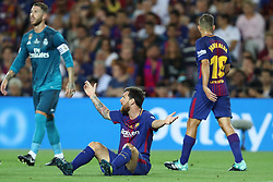 August 13, 2017 - Barcelona, Spain - Lionel Messi of FC Barcelona reacts after being tackled during the Spanish Super Cup football match between FC Barcelona and Real Madrid on August 13, 2017 at Camp Nou stadium in Barcelona, Spain. (Credit Image: © Manuel Blondeau via ZUMA Wire)