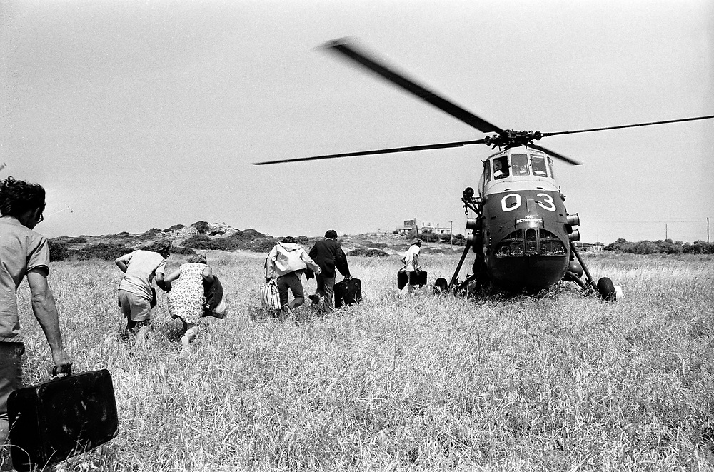 Cyprus War 20 July–18 August 1974. Turkish invasion of Cyprus code-name by Turkey, Operation Attila. British holiday makers are evacuated by a Royal Navy Wessex helicopter from HMS Hermes near Kyrenia July 1974. Photo by Terry Fincher.