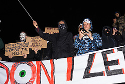 London, November 05 2017. Anti-capitalists gather in Trafalgar Square, London for the annual 'Million Mask March' which happens on November 5th every year, with many of the protesters donning 'V' For Vendetta Guy Fawkes masks. Past marches have turned violent with police horses shot by fireworks and police vehicles burned. PICTURED: Protesters on the plinth of Nelson's Column after marching to and from Parliament Square. © Paul Davey