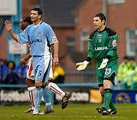 Photo. Glyn Thomas. 22/02/2005.<br /> Coventry City v Stoke City. Coca Cola Championship.<br /> Coventry keeper Ian Bennett (R) protests his innocence after being shown the red card for handling the ball outside the penalty area.