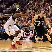 Anna Cruz, (right), New York Liberty, drives to the basket defended by Chiney Ogwumike, Connecticut Sun, during the Connecticut Sun Vs New York Liberty WNBA regular season game at Mohegan Sun Arena, Uncasville, Connecticut, USA. 16th May 2014. Photo Tim Clayton