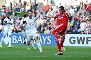 Swansea city's Michu (l) challenges WBA's Jonas Olsson.  Barclays Premier league match, Swansea city v West Bromwich Albion at the Liberty Stadium in Swansea, South Wales on Saturday 15th March 2014. pic by Andrew Orchard,  Andrew Orchard sports photography.