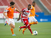 FRISCO, TX - JUNE 12:  Jackson #6 of FC Dallas brings the ball up the field past Mike Chabala #6 and Luiz Camargo #17 of the Houston Dynamo on June 12, 2013 at FC Dallas Stadium in Frisco, Texas.  (Photo by Cooper Neill/Getty Images) *** Local Caption *** Jackson; Mike Chabala; Luiz Camargo