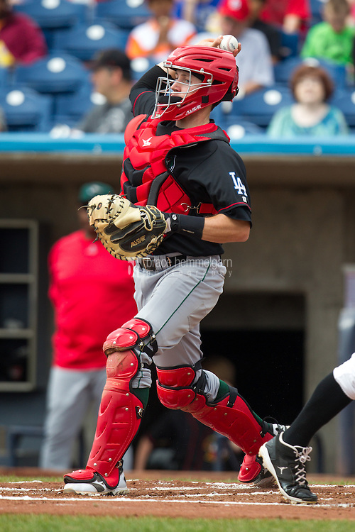 Great Lakes Loons catcher Eric Smith #10 throws during a game against the Quad Cities River Bandits at Modern Woodmen Park on April 29, 2013 in Davenport, Iowa. (Brace Hemmelgarn)
