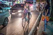 01 APRIL 2013 - BANGKOK, THAILAND:   Amy Hupe with daughters Arielle and Elijah on board pedal through Bangkok traffic.  PHOTO BY JACK KURTZ