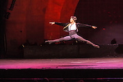 A dancer from Les Ballets Trockadero de Monte Carlo in a dramatic leap. The troupe, all males, is very athletic.