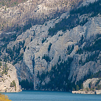 Towering limestone cliffs rise above the Gates of the Rocky Mountains, a gorge flowing out of Upper Holter Lake, on Montana's  Missouri River.