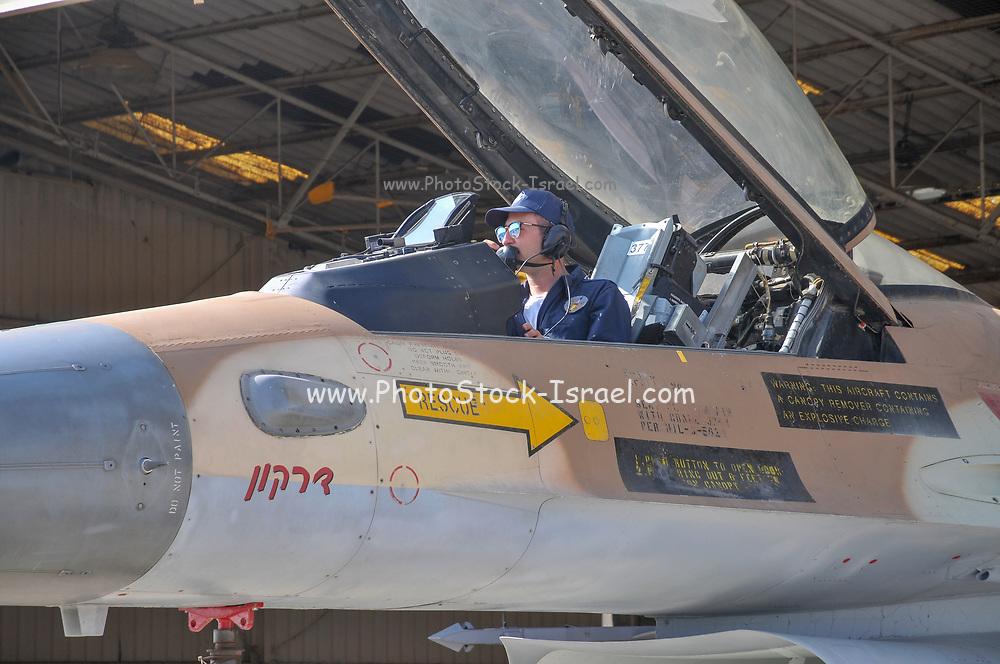 Technician in the cockpit of an IAF f-16