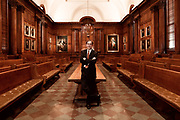 """Princeton University President Chris Eisgruber poses for a portrait in the faculty room of Nassau Hall in Princeton, New Jersey, Monday, December 30, 2013. The walls are adorned with portraits of former U.S. President George Washington and former presidents and Princeton University.  Eisgruber has gone on what he describes as """"a listening tour"""", in which he is getting feedback from Princeton alumni to get a better sense of which direction to take the University in the future.  Emile Wamsteker for The Wall Street Journal<br /> <br /> NYPRINCE"""