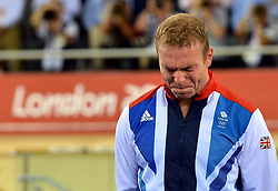 File photo dated 07-08-2012 of Great Britain's Sir Chris Hoy becomes emotional as he celebrates winning Gold in the Men's Keirin Final