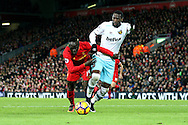 Sadio Mane of Liverpool and Pedro Mba Obiang of West Ham United battle for the ball. Premier League match, Liverpool v West Ham Utd at the Anfield stadium in Liverpool, Merseyside on Sunday 11th December 2016.<br /> pic by Chris Stading, Andrew Orchard sports photography.
