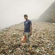 Prem, a recycler looking for metal in Bhalswa, a giant open air garbage dump which burns 24/7, creating toxic fumes.