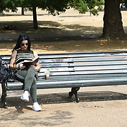 UK Weather: People reading book in Hype park as heatwave continues in London, UK. July 26 2018.