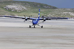 Barra Airport is a short-runway airport situated in the wide shallow bay of Traigh Mhòr at the north tip of the island of Barra in the Outer Hebrides, Scotland. Barra is now the only beach airport anywhere in the world to be used for scheduled airline services. Loganair Twin Otter landing. (c) Stephen Lawson   Edinburgh Elite media