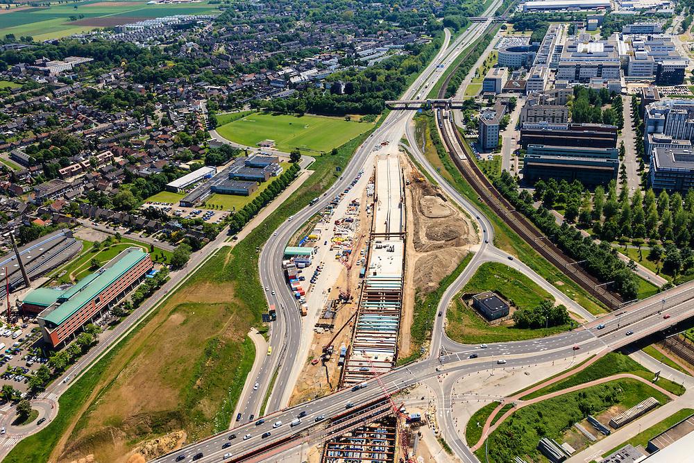 Nederland, Limburg, Maastricht, 27-05-2013; bouwwerkzaamheden voor de A2 traverse, De Groene Loper. <br /> Tunnelbouwkuip Europaplein. Maastrichts Expositie & Congres Centrum (MECC) en Academisch Ziekenhuis Maastricht (AZM) in de achtergrond. <br /> De snelweg A2 gaat ondergronds, er wordt een gestapelde tunnel gebouwd (2 wegen boven elkaar). Het plan moet voor een betere bereikbaarheid en leefbaarheid van Maastricht zorgen en ook voor een betere doorstroming op de A2.<br /> Construction works for motorway A2 crossing Maastricht, the so-called Green Carpet.<br /> The A2 motorway goes underground, a stacked tunnel is  built with two roads above each other). The plan should provide better accessibility and traffic flow.<br /> luchtfoto (toeslag op standard tarieven);<br /> aerial photo (additional fee required);<br /> copyright foto/photo Siebe Swart.