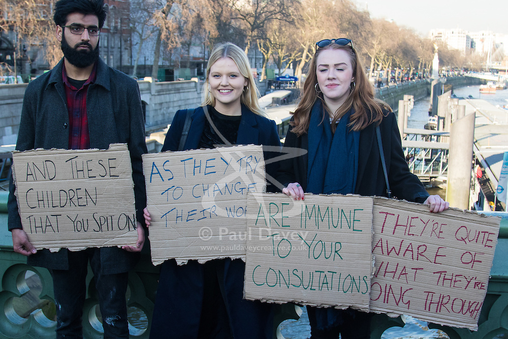 """Westminster, London, January 19th 2016. Students hold an """"emergency protest"""" in Parliament Square and later blocking Westminster Bridge, against the cutting of maintenance grants. """"It took just 18 MPs 90 minutes to scrap maintenance grants for the million poorest students, without a debate in Parliament in a backroom committee"""" PICTURED: Protesters display their placards on Westminster Bridge. ///FOR LICENCING CONTACT: paul@pauldaveycreative.co.uk TEL:+44 (0) 7966 016 296 or +44 (0) 20 8969 6875. ©2015 Paul R Davey. All rights reserved."""