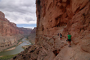 Tourist near the Indian ruins of Nankoweep,with the view on the Colorado river,Grand Canyon River trip,Arizona,USA