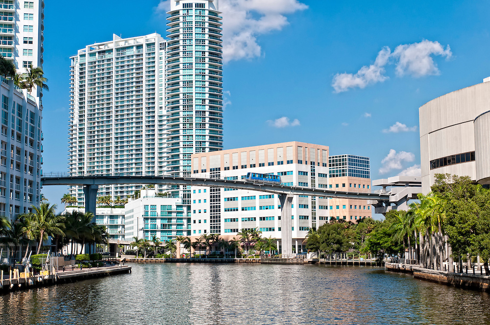 View of the Miami River and metrorail overpass with modern buildings