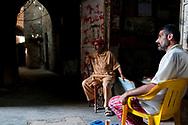 Sidon, Lebanon - September 24, 2010: Lebanese men in Sidon's old city