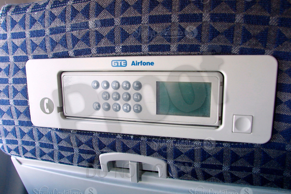 Jun 21, 2002; Dallas, TX, USA; Delta Airlines airfone by GTE placed in the back of airplane seat head rests. Cell phones and other telephones are banned for use during flights eventhough passengers have used them in cases of severe emergencies such as the airplane terrorist attacks in 2001. Mandatory Credit: Photo by Shelly Castellano/ZUMA Press. (©) Copyright 2002 by Shelly Castellano
