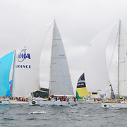 A downwind spinnaker start for the 100-stong fleet of the 2009 Rolex Sydney to Harbour Yacht Race in Sydney Harbour.
