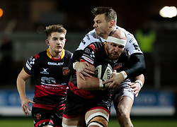 Dragons' Rynard Landman under pressure from Ospreys' Dan Biggar<br /> <br /> Photographer Simon King/Replay Images<br /> <br /> Guinness Pro14 Round 12 - Dragons v Cardiff Blues - Sunday 31st December 2017 - Rodney Parade - Newport<br /> <br /> World Copyright © 2017 Replay Images. All rights reserved. info@replayimages.co.uk - http://replayimages.co.uk