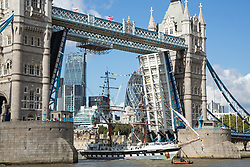 © Licensed to London News Pictures. 24/09/2014. Tall ship departs through Tower Bridge. Young people on board the Stavros S Niarchos tall ship manned the yard arms today as she sailed through an opened Tower Bridge. On a warm, sunny September afternoon, the tall ship which is owned and operated by the Tall Ships Youth Trust sailed up the Thames as part of the HSBC Voyage of Achievement. Credit : Rob Powell/LNP