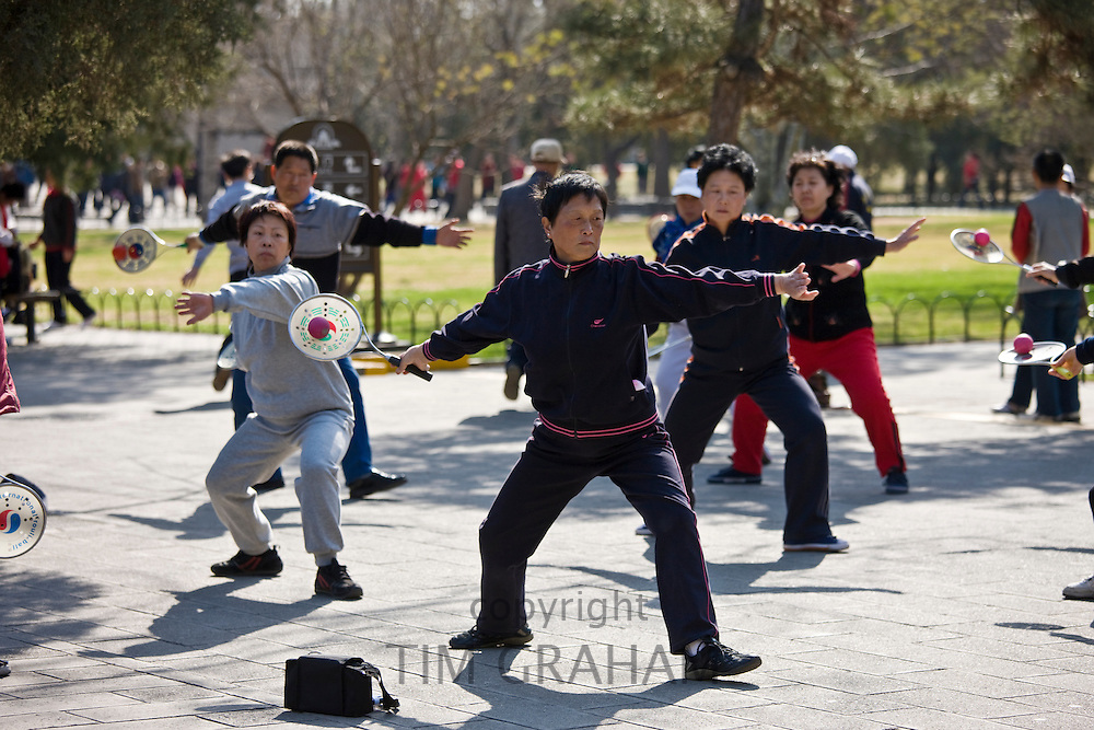 Tai chi with bat and ball in park of the Temple of Heaven, Beijing, China